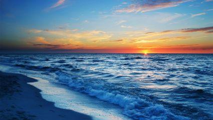 ocean tide at sunset
