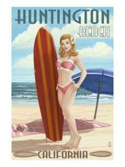 woman in bikini with surfboard