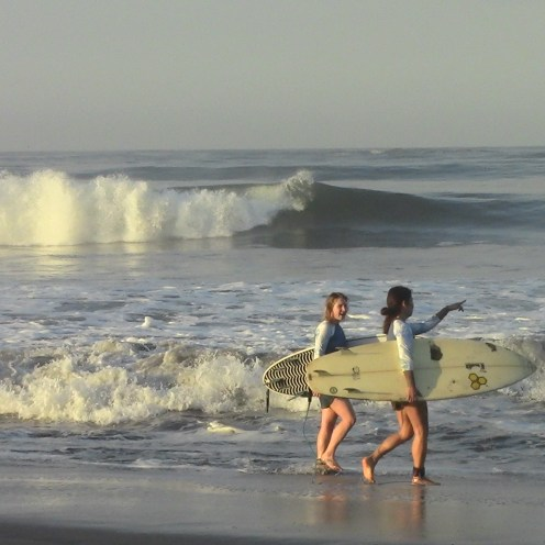A couple of our shortboarders prepare to paddle out in the channel.