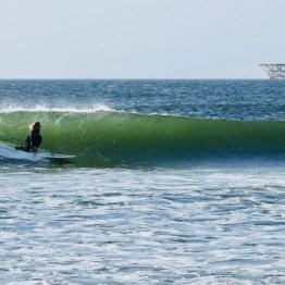 Surfing in Chicama, Peru