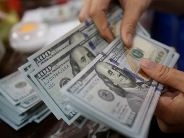 Dólar fecha o dia em alta de 0,26%, cotado a R$ 3,697