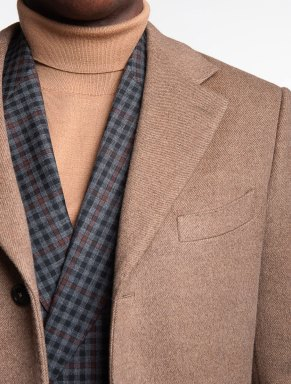 camel cozy wool turtleneck with a jacket