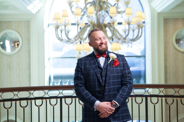 Man wearing a blue checkered suit for his wedding