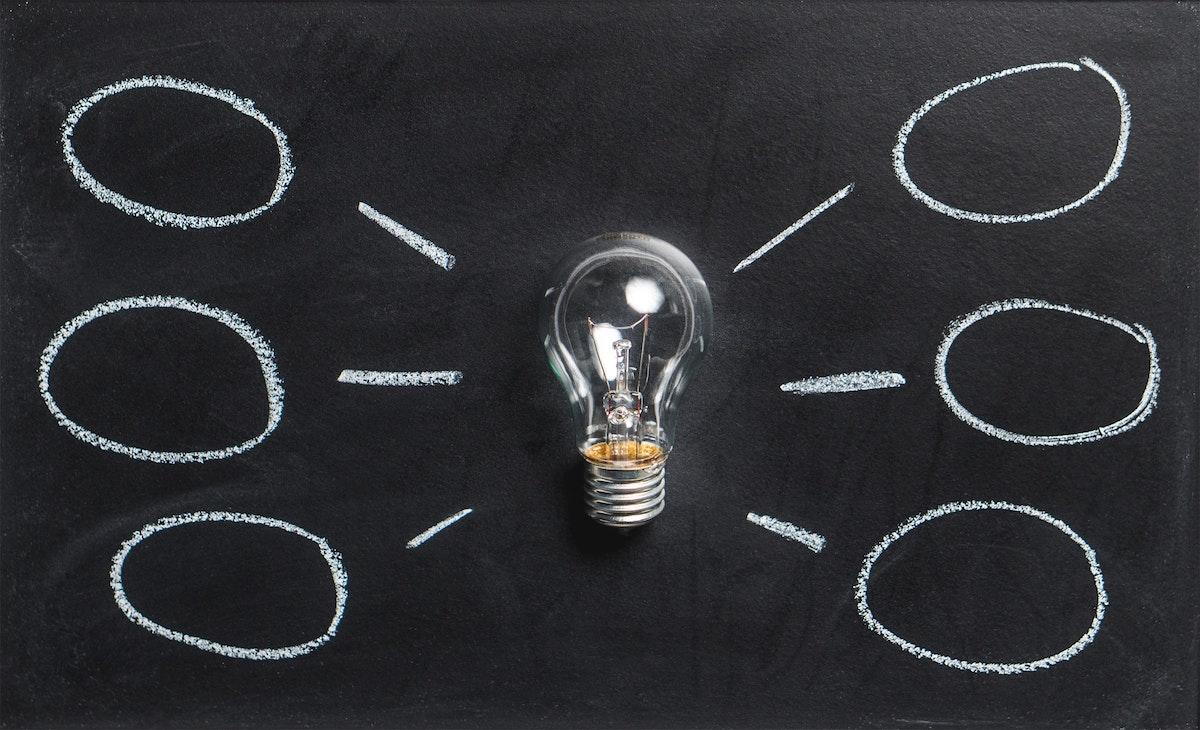 lightbulb on blackboard for energy strategy blog