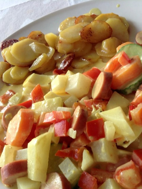 turnip cabbage with carrots and sausages