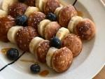 Dutch mini buckwheat pancakes with banana and blueberries
