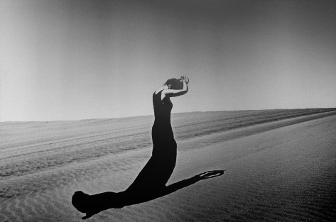 Black and White photo of woman in desert