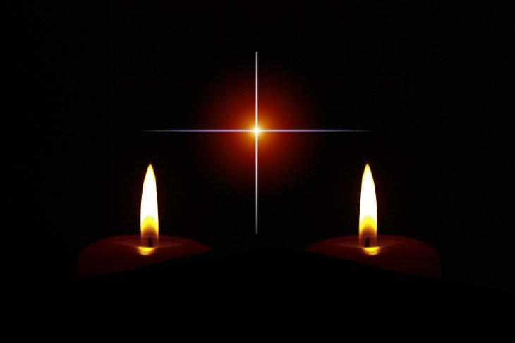 A photo of two candle flames