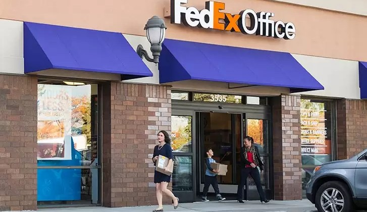 Customers leaving FedEx Office Store - One Rate