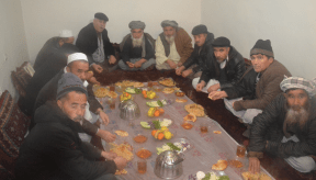 Friends and Family of the man who has died eating the food that is dedicated to the man as a ritual.