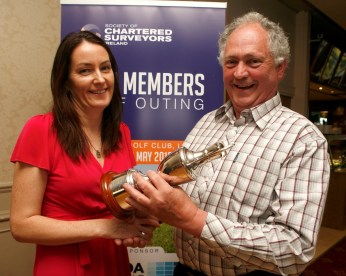 Marie Connolly of APCOA presenting the winning cup to Eddie King - King Auctioneers