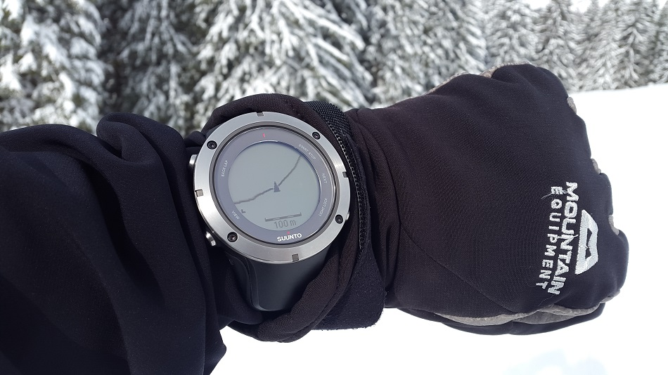 A photo of a  wrist hand held gps unit on a wrist