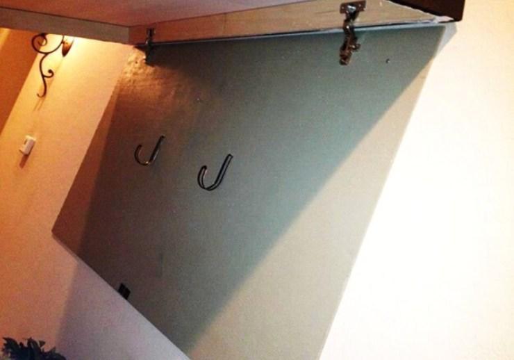 Mount the Frame & Add L Hooks | diy hidden gun storage picture frame