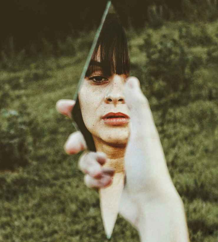 Woman holding a broken mirror | SELF DEFENSE: Escaping Your Captors in the City
