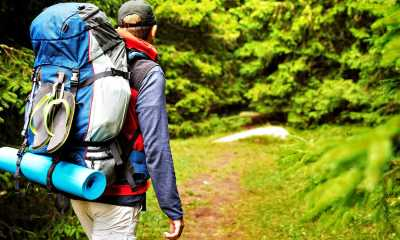 Featured | Male backpacker hiking/tracking through mountain forest | Preparing Your INCH Bag