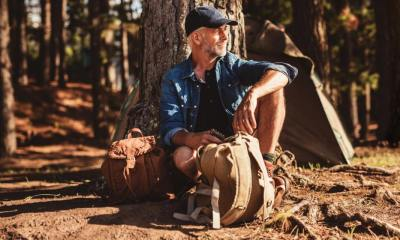 portrait senior man sitting under tree | Wilderness DIY: How to Make Your Own Bushcraft Camp Chair | featured