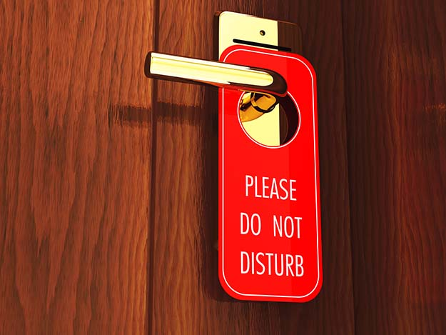 A do not disturb sign will make intruders think you are in the room even if you're not.