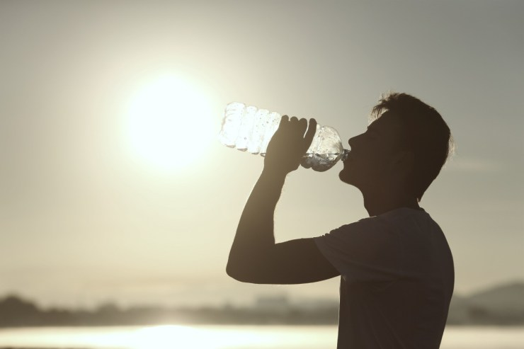silhouette of a man drinking water | The Limits Of The Human Body | limits of the human body | physical limits of the human body