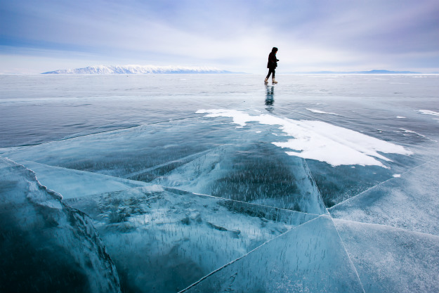 person-wakling-on-cracked-ice Thin Ice Ahead! How To Rescue Someone Who Has Fallen Through Ice