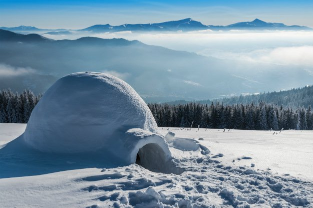 snow-shelter-igloo-with-landscape-behind Snow Shelter: Learn How to Build a Snow Cave For Winter Survival