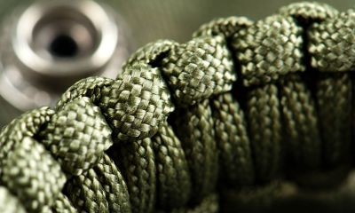 Closeup braided green paracord bracelet | How To Make A Paracord Belt To Stay Prepared [Video] | Featured