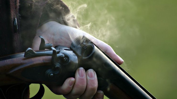 A person holding shotgun | These Hunting Shotguns Are The Best Bang For Your Buck