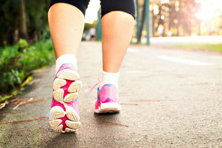 Woman Wearing Pink Sports Shoes Walking | Minimalist Footwear...An Ultralight Essential? [Gear Review]