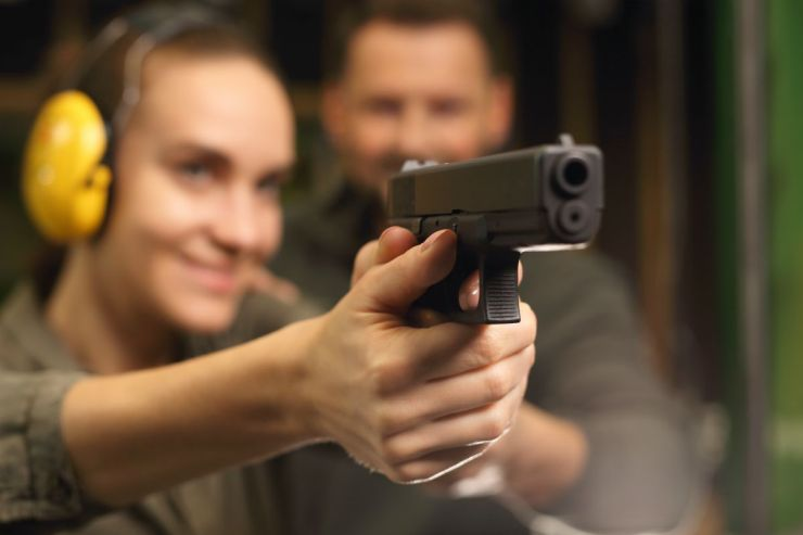 Woman takes lessons in shooting with a handgun on the shooting range | Conquering The Cornerstones: Self-Defense - The 4th Pillar of Survival