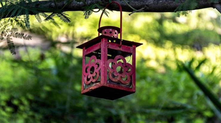 Hanging red lantern | Badass Camping Hacks For Your Next Trip