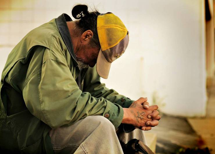 Homeless man sitting in the street | Homeless Survival Tips | How To Survive On The Streets