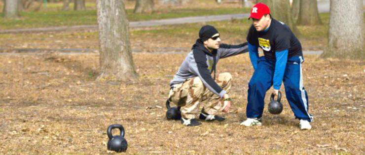 Man practice kettlebell with his trainer   Why The Kettlebell Is The Ultimate Tool For Physical Preparedness