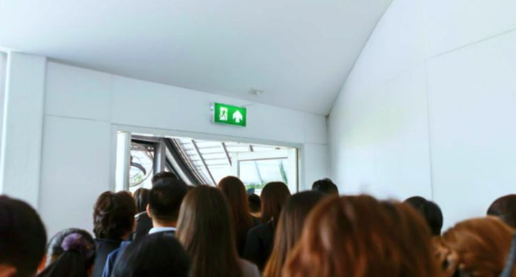 Group of people in the fire exit | Tips For Sheltering In Place