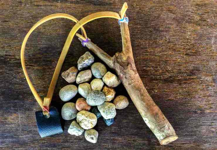 Slingshot and stones | How To Sight In A Slingshot And Score An Easy Meal