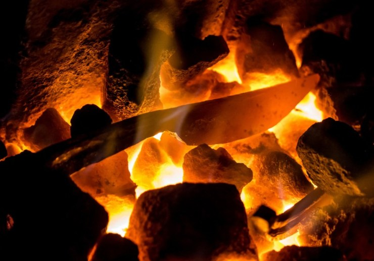 blazing furnace burning coal blacksmiths | homemade forge plans