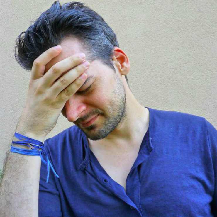 Man holds his head | Vicks Vaporub | Surprising Reasons To Keep It In Your Cache