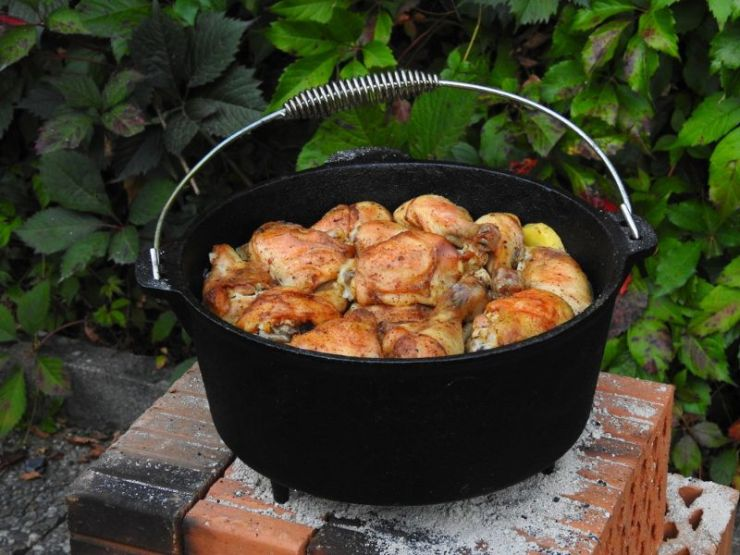 child-hand-dirty-nails-outdoors-holding | dutch oven