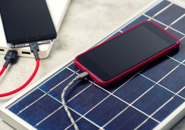 charging smartphone solar energy green concept | solar charger for phone