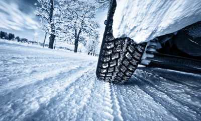 Car tires on winter road | winter driving tips