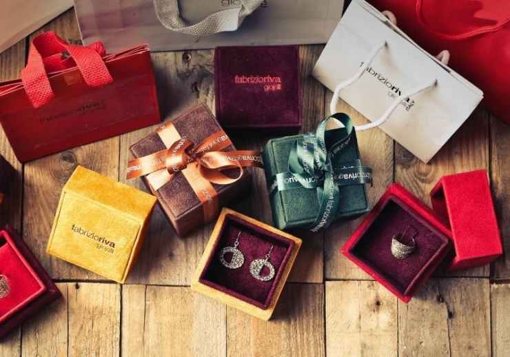Assorted gift boxes on brown wooden floor surface| Christmas Survival Guide | How to Survive Christmas
