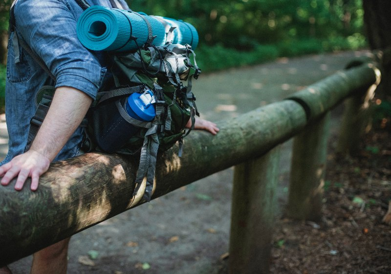 Crop man with backpack in forest _ potable water px