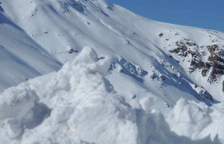 snow covered mountain under blue sky during daytime | how to prepare for an avalanche