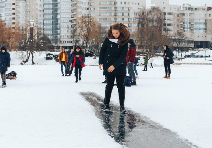 Walking on the ice of a frozen river Girl is riding on ice | Walking on Ice | SS-Featured