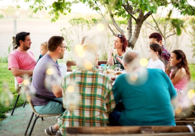 big family having meal outside table | new year tips 2021