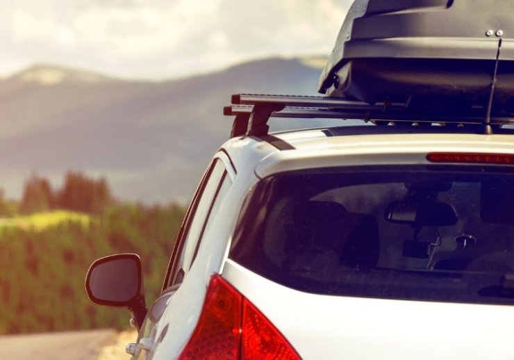 car traveling roof rack on mountain | wellness tips for the new year