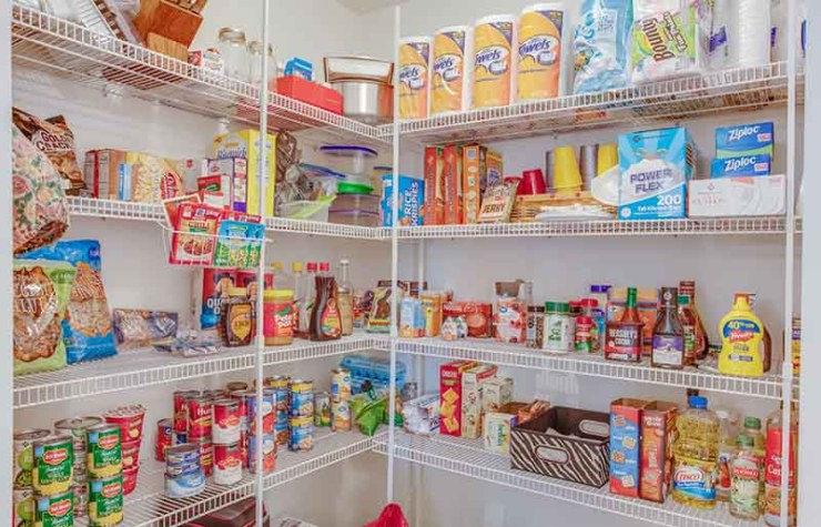 large pantry stocked with food and paper products | how to build a bunker