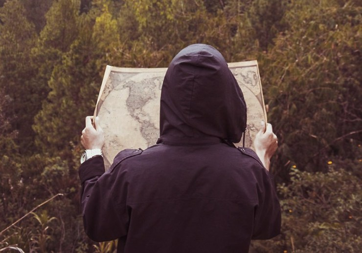 person reading a map | travel backpacking checklist