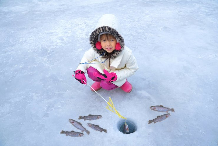 Cute girls are sitting on the floor of ice fishing | ice fishing science experiment