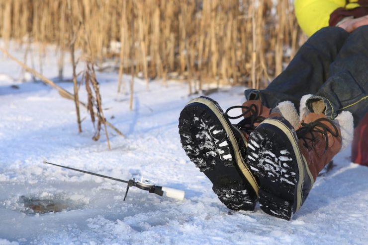 Ice fishing on frozen lake | ice fishing fish