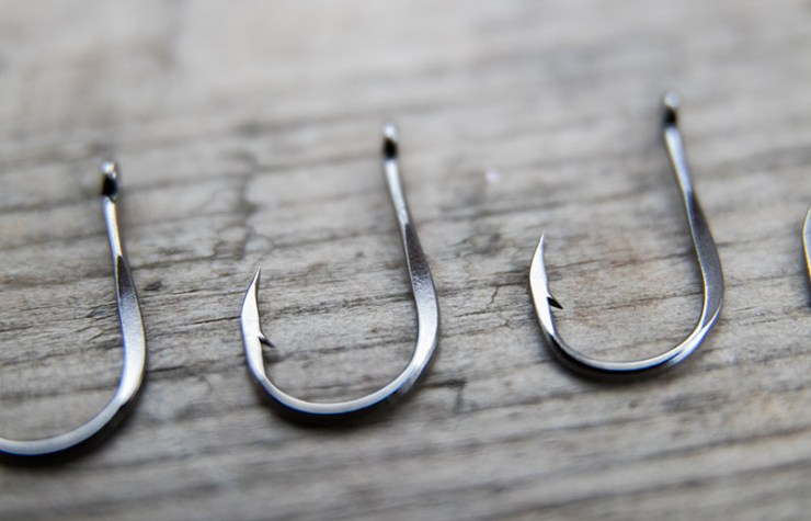 fish hooks on gray wooden board | ice fishing lures