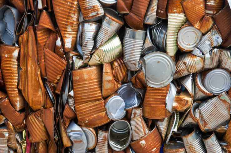 Crushed tin cans at a recycling center | Perimeter alarms for yards